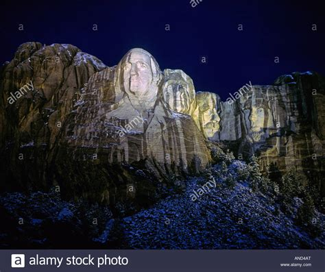 Rain and melting snow streak the giant stone faces at