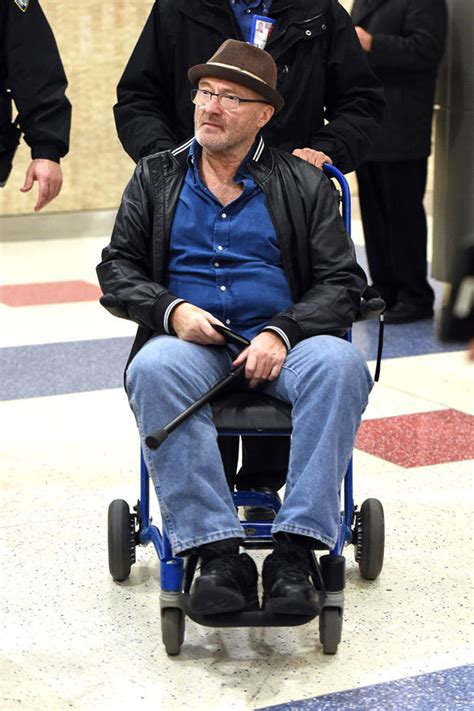 Phil Collins seen in wheelchair as he recovers from major