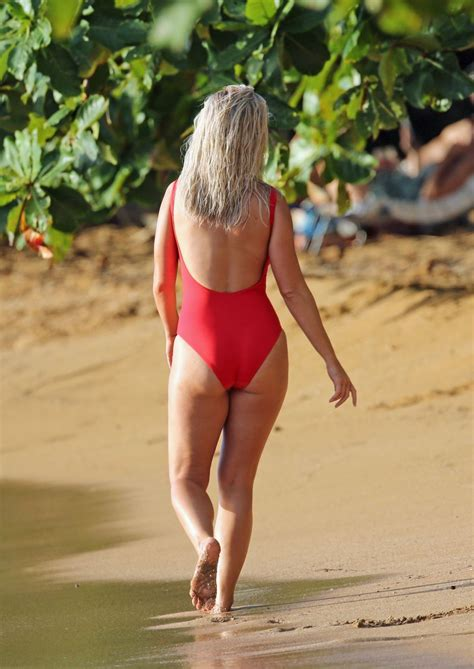 Katy Perry Poses on a beach in a red swim suit as she